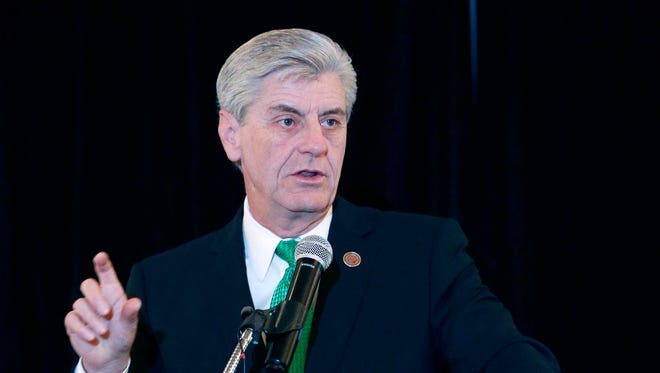 """Mississippi Gov. Phil Bryant, who was in Washington recently accepting an award from the conservative Family Research Council for signing the state's religious objections law this year and and a similar one in 2014 called the Mississippi Religious Freedom Restoration Act, said the """"secular, progressive world"""" vented at him for signing House Bill 1523. He's pictured here in a May file photo."""