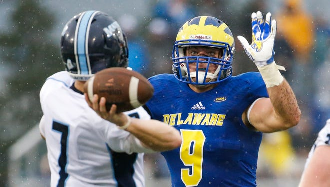 Delaware linebacker Troy Reeder pressures Maine quarterback Dan Collins in the second quarter at Delaware Stadium in Oct. 2016.