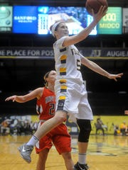 Augustana's Sophie Kenney goes up for a shot against