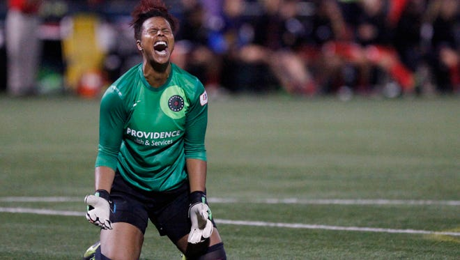 Portland Thorns' goal keeper Karina LeBlanc reacts euphoric when her team scores the second goal winning the 2013 NWSL Championship Game 2-0, Saturday, Aug. 31, 2013.