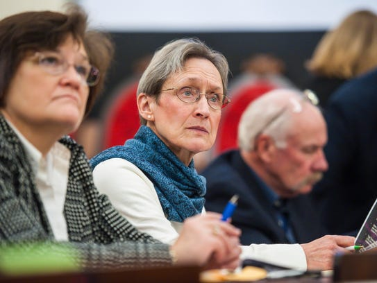 Rep. Maida Townsend, D-South Burlington, center, listens