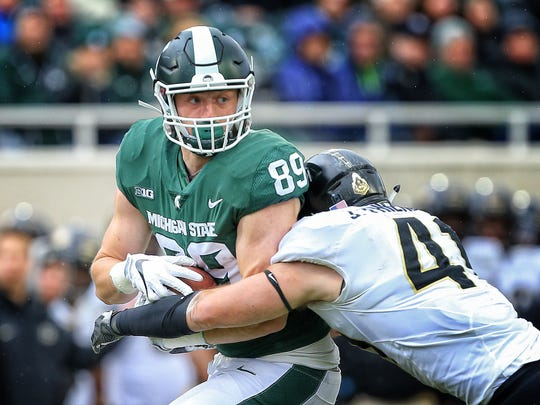 Oct 27, 2018; East Lansing, MI, USA; State Spartans tight end Matt Dotson (89) is tackled after a catch by Purdue Boilermakers safety Jacob Thieneman (41) during the first half of a game at Spartan Stadium. Mandatory Credit: Mike Carter-USA TODAY Sports