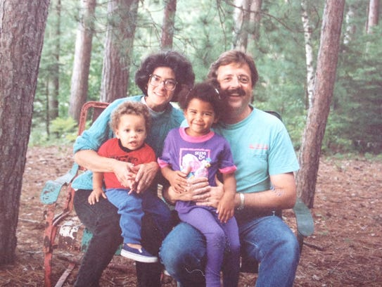 Rose Curley and her family outside their cabin in northern
