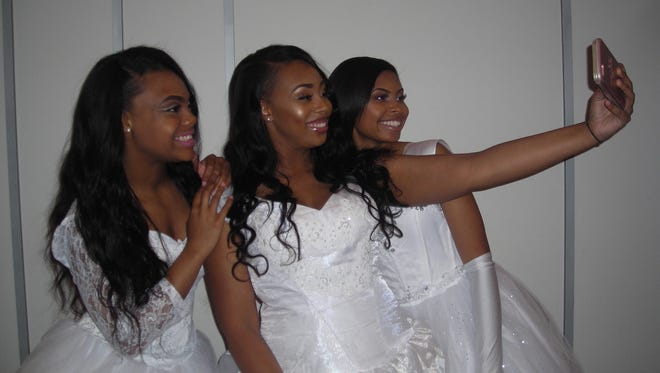 Showing how a selfie is done are AKA Debs:   Ketreia Andrews, Chelsea Como and Chelsea Jackson.