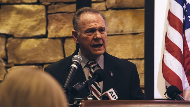 The GOP's Alabama Senate candidate Roy Moore speaks during a mid-Alabama Republican Club's Veterans Day event on Saturday.