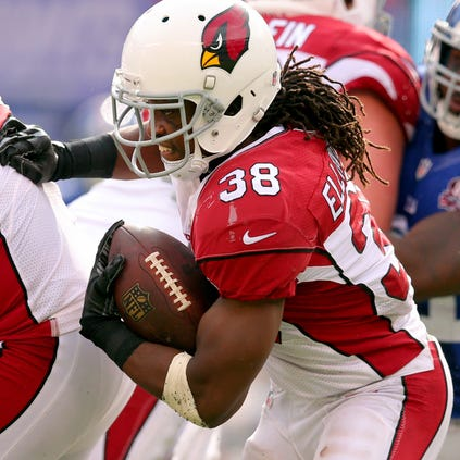 Arizona Cardinals running back Andre Ellington runs the ball against the New York Giants on Sept. 14, 2014, at MetLife Stadium.