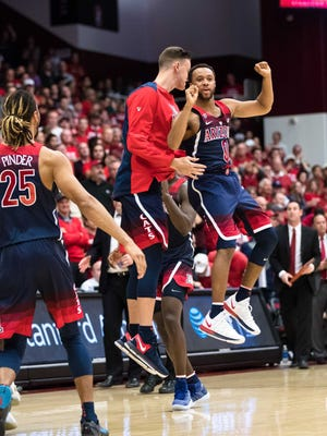 Arizona Wildcats guard Parker Jackson-Cartwright (0) celebrates their win over the Stanford Cardinal at Maples Pavilion.