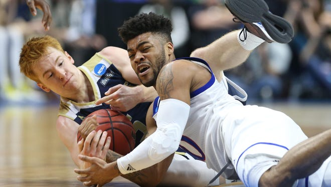 Kansas Jayhawks guard Frank Mason III (0) and UC Davis Aggies guard Siler Schneider (5) battle for a loose ball during the first half in the first round of the 2017 NCAA Tournament at BOK Center.