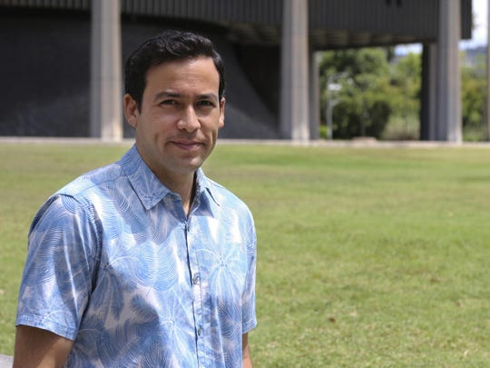 Hawaii state Rep. Chris Lee poses in front of the capitol. Hawaii is considering doling out universal basic income, where everyone gets a chunk of money with no strings attached, and Lee is a supporter.