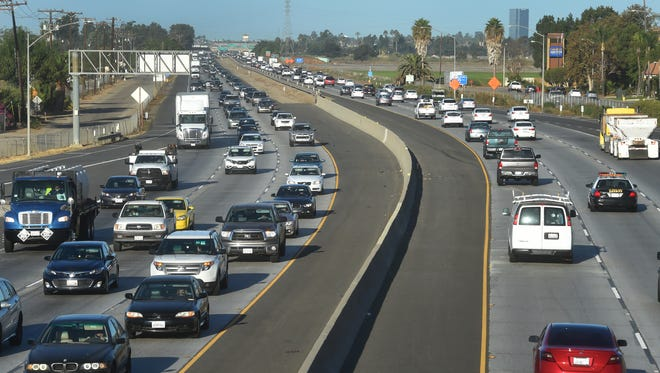 A proposed half-cent transportation sales tax measure is on Ventura County's Nov. 8 ballot. Backers say revenues generated by the tax would be used for a variety of transportation upgrades, including widening sometimes-jammed Highway 101, shown here in Camarillo during a recent morning rush hour.