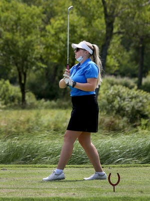 Nickerson's Makenna Dodson tees off on the third hole during the Nickerson Invitational Tournament Monday at Crazy Horse Golf Course.