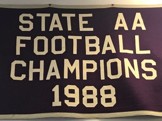 A blanket that Clark Tuthill keeps in his garage commemorates Shasta High's football team being named state Division AA champs in 1988.