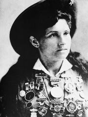 Annie Oakley, American sharpshooter and performer,