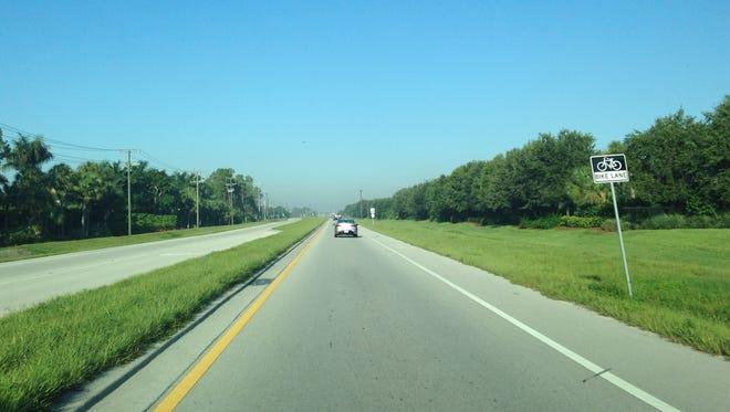 Heading west on corkscrew towards I-75 smoke is visible on the horizon.