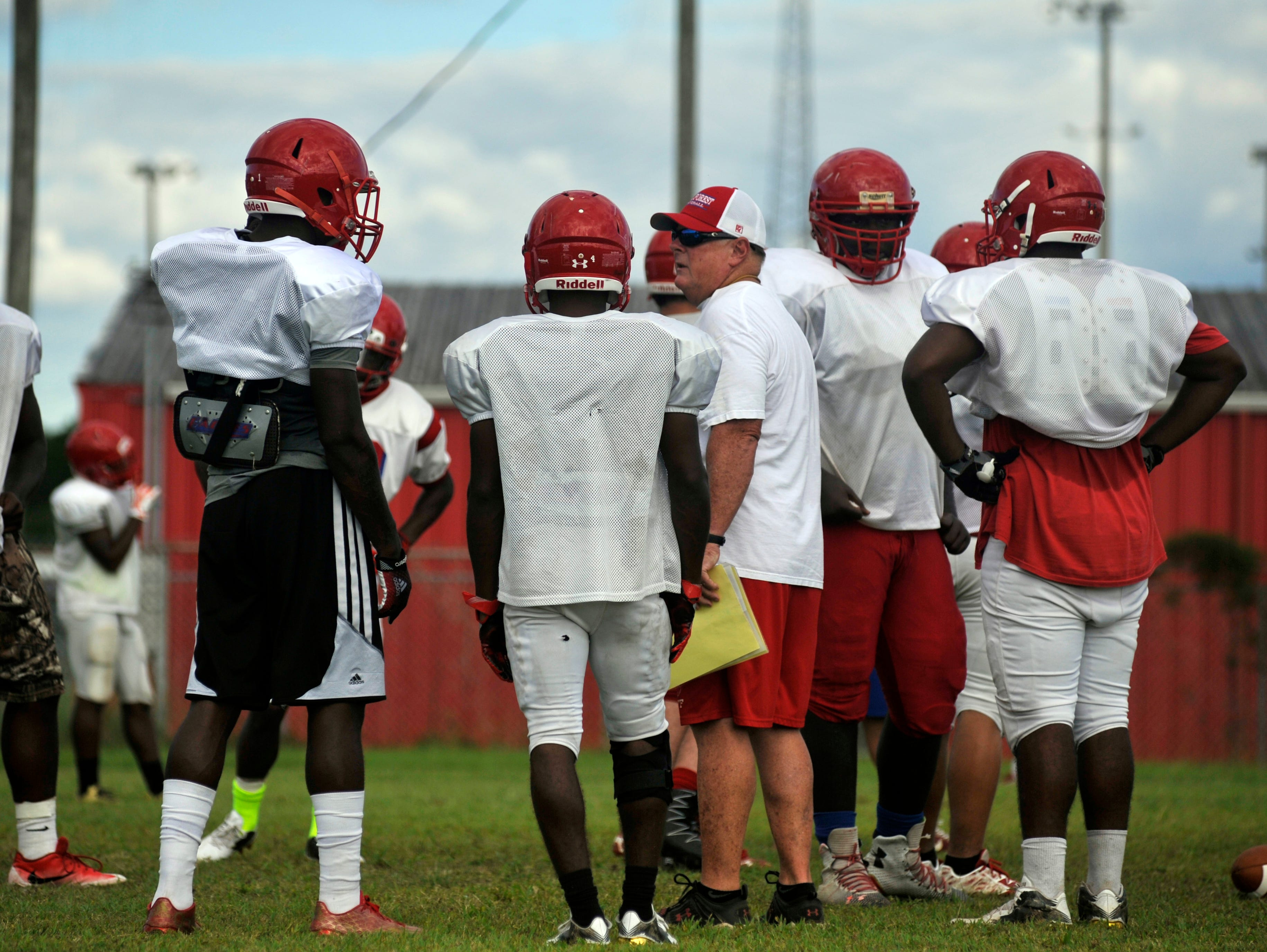 Pine Forest head coach Jerry Pollard speaks to his team during practice on Sept. 14, 2016.