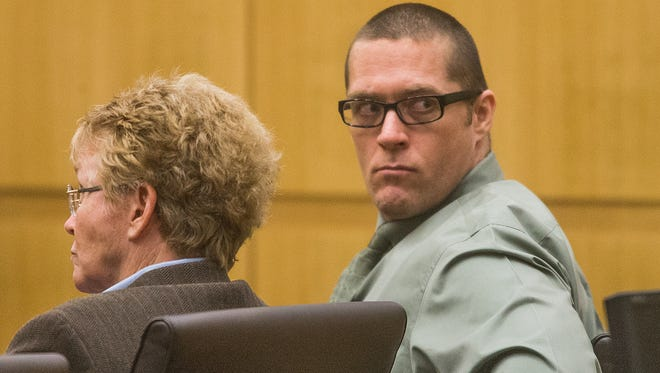 Wayne Hulsey looks around as the jury convicts him of first-degree murder and attempted first-degree murder in Maricopa County Superior Court, Monday, July 28, 2014. Hulsey killed Glendale police Officer Anthony Holly in 2007.