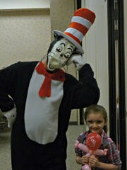 Lauren Bosco and the Cat in the Hat share a smile during