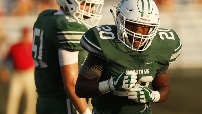 Athens Academy's Tae Clay (20) celebrates after taking down Savannah Christian's Jordan Grant (2) behind the line during a GHSA high school football game between Athens Academy and Savannah Christian in Athens, Ga., on Friday, August 17, 2018. Clay is a rising sophomore at Morehouse College, where the upcoming football season was canceled last month due to the coronavirus pandemic.