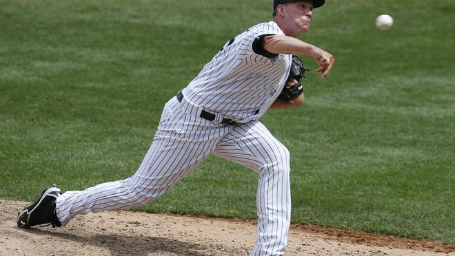 Yankees relief pitcher Danny Burawa delivers in the sixth inning against the Detroit Tigers. Burawa, who made his Major League debut Sunday, allowed four runs on three hits, including a three-run home run in two-thirds of an inning.