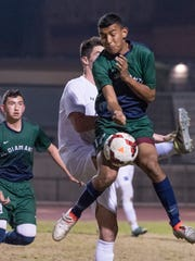 El Diamante's Jacob Perez, right, and Redwood's Cade Batchman collide midfield in a West Yosemite League high school boys soccer match on Wednesday, January 31, 2018.