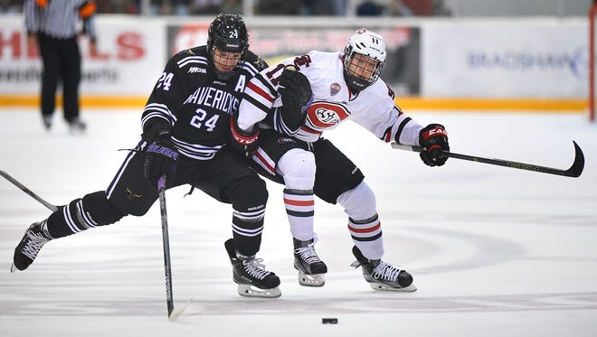 Brett Knowles of Minnesota State-Mankato and St. Cloud State's Kalle Kossila battle for control of the puck during a game at Herb Brooks National Hockey Center in St. Cloud.