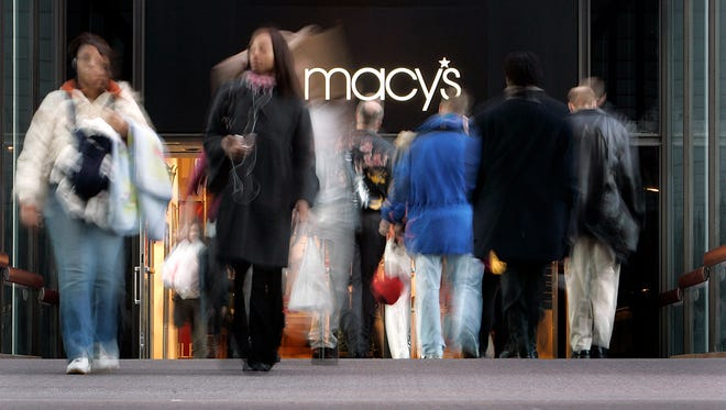 This photo taken Feb. 6, 2008 shows Macy's ' pedestrians walking in and out of Macy's in the skyway connecting it to the IDS Building in downtown Minneapolis. (Carlos Gonzalez/Star Tribune via AP)