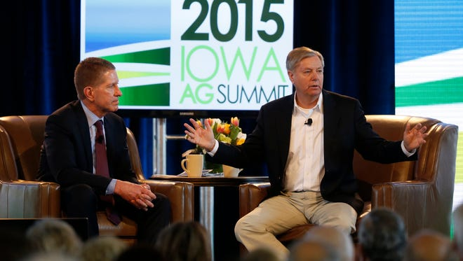 Sen. Lindsey Graham (right) talks with Bruce Rastetter Saturday, March 7, 2015 during the Iowa Ag Summit in Des Moines.