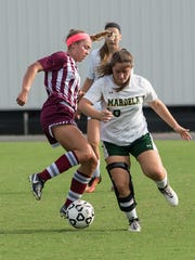 Snow Hill's Kelsey Hall (10) battles for possession