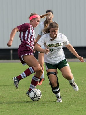 Snow Hill's Kelsey Hall (10) battles for possession during a game against Mardela on Monday, Oct. 9, 2017.