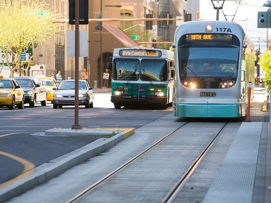 A light-rail train travels on Central Avenue in downtown Phoenix.