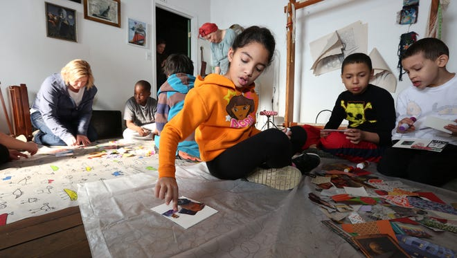 Fourth-graders from North Rockland School District's Farley Elementary School make collages during a visit to the Bubble and Fizz studio at the Garner Arts Center in Garnerville on Jan. 21, 2016.