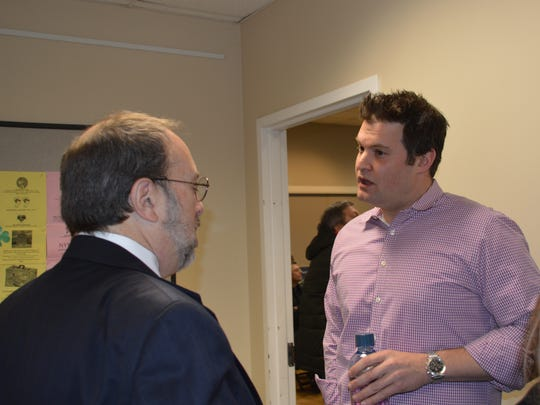 Jeff Sherwin, right, who leads the Edgemont Incorporation Committee, speaks with town of Greenburgh attorney Robert Spolzino at a public hearing on incorporation.
