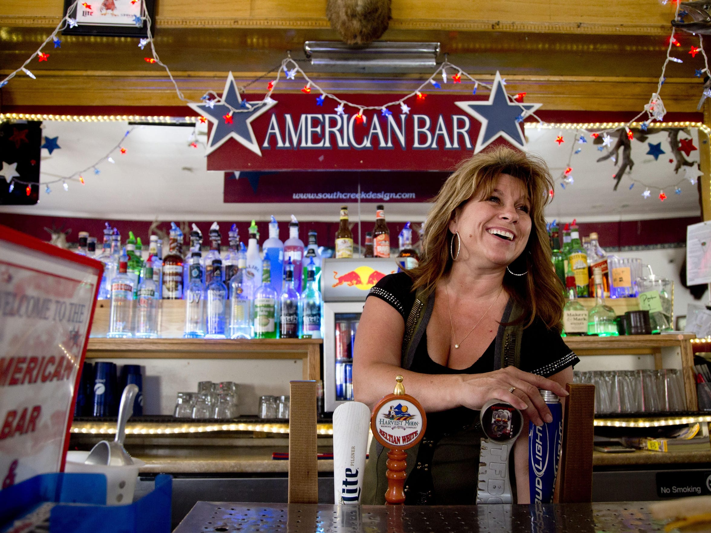 2 bar owner Deana pours a beer