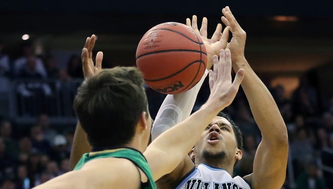 Notre Dame's Steve Vasturia (32) blocks a shot by Villanova's Josh Hart (3) Saturday.