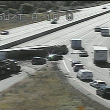 A truck rollover is snarling midday traffic on I-35W in Moundsview.