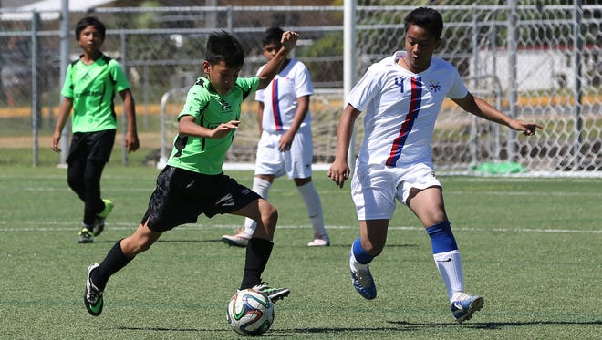 The ASC Trust Islanders' Javian Cruz prepares to strike the ball against visiting team Don Bosco of the Philippines in an opening day U14 division match of the Youth Invitational Gobblefest soccer tournament at the Guam Football Association National Training Center Friday. The Islanders won 5-1.