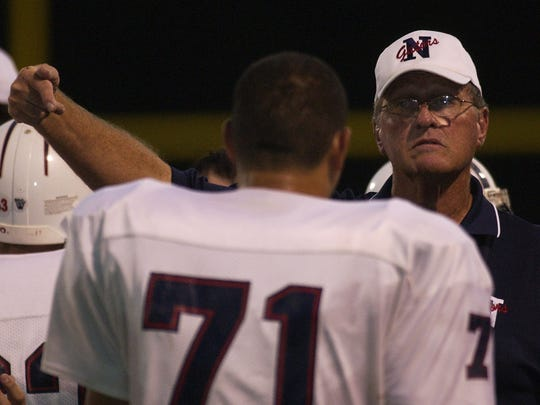 Tom O'Kelly talks with his Northwood players during a break in the action during a game in 2006. O'Kelly has coached and taught at several area schools. He is currently an assistant at Tioga.
