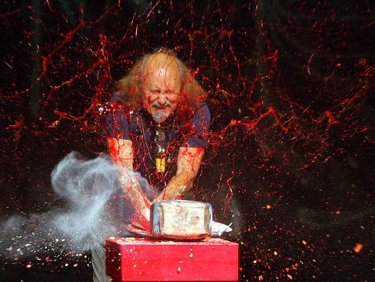 Gallagher smashes strawberry syrup and flour in 2006.