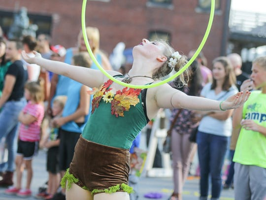 A woman hula hoops in the 2017 Art Squared Parade hosted