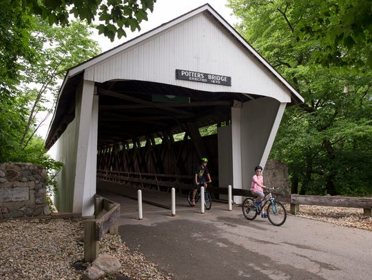Bike riders emerge from the span of Potters Bridge,