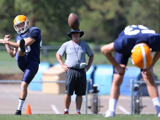 Australian kicker Mitchell Crawford works on his American football skills during Camp Ruidoso Wednesday. The Australian rules footballer had never stepped on an American football field until joining the MIners.