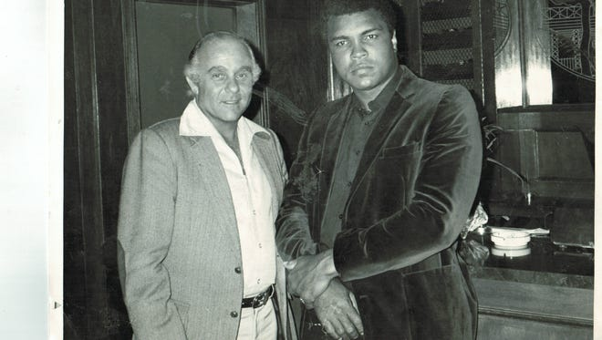 Westlake Village resident David Mirisch poses with Muhammad Ali in this photo, one of many that will be on display at the Museum of Ventura County.