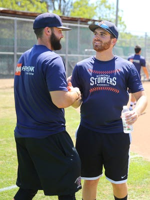 Sonoma Stompers pitcher Sean Conroy, right, gets a handshake from catcher Isaac Wenrich during practice at Arnold Field, in Sonoma, Calif.
