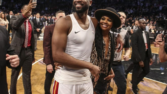 Former Miami Heat guard Dwayne Wade, left, and his wife Gabrielle Union are supporting their 12-year-old, who goes by Zaya now instead of her birth name Zion.