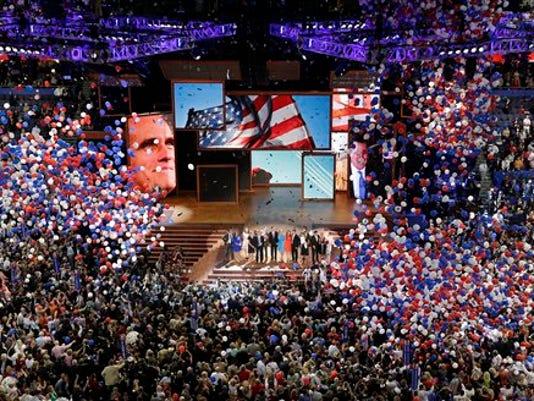 FILE - In this Aug. 30, 2012, file photo, Republican presidential nominee Mitt Romney and vice presidential nominee Rep. Paul Ryan are joined on the stage by their families at the end of the Republican National Convention in Tampa, Fla. Representatives for news organizations who plan to cover the 2016 convention are protesting a move by the Republican National Committee to charge news media organizations a $150 access fee for seats on the press stand.
