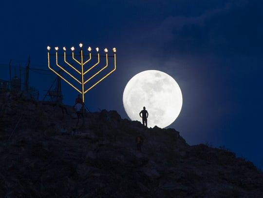 A Menorah on a moonlit night.