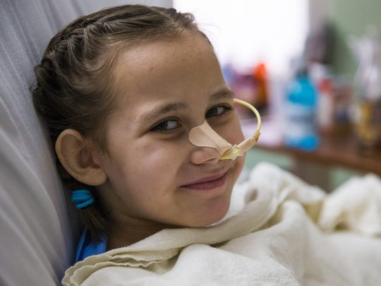Eight-year-old Isabella McCune recovers at the Arizona