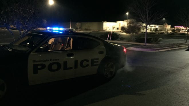 A Mountain Home Police patrol car is seen at the area of a reported armed robbery near El Chico on Sunday night.