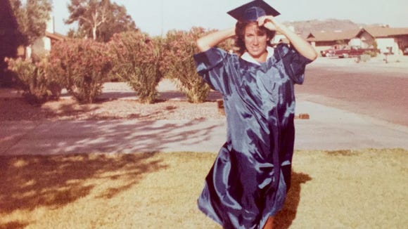 Karina Bland at 18, in cap and gown for graduation from Thunderbird High, 1983.