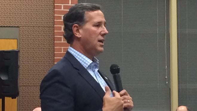 Rick Santorum speaking to the Republican Party of Polk County Central Committee Tuesday evening in Des Moines.